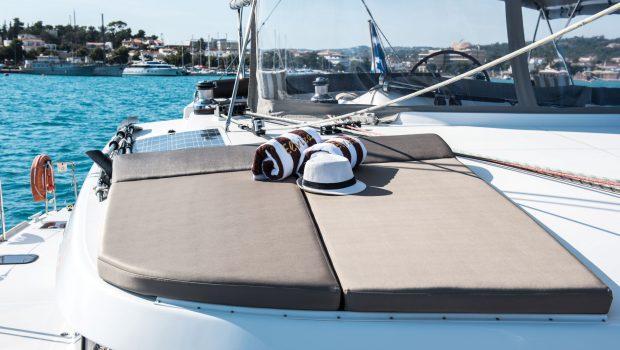 elvira catamaran lagoon 500 sun bathing (1)_valef -  Valef Yachts Chartering - 5563
