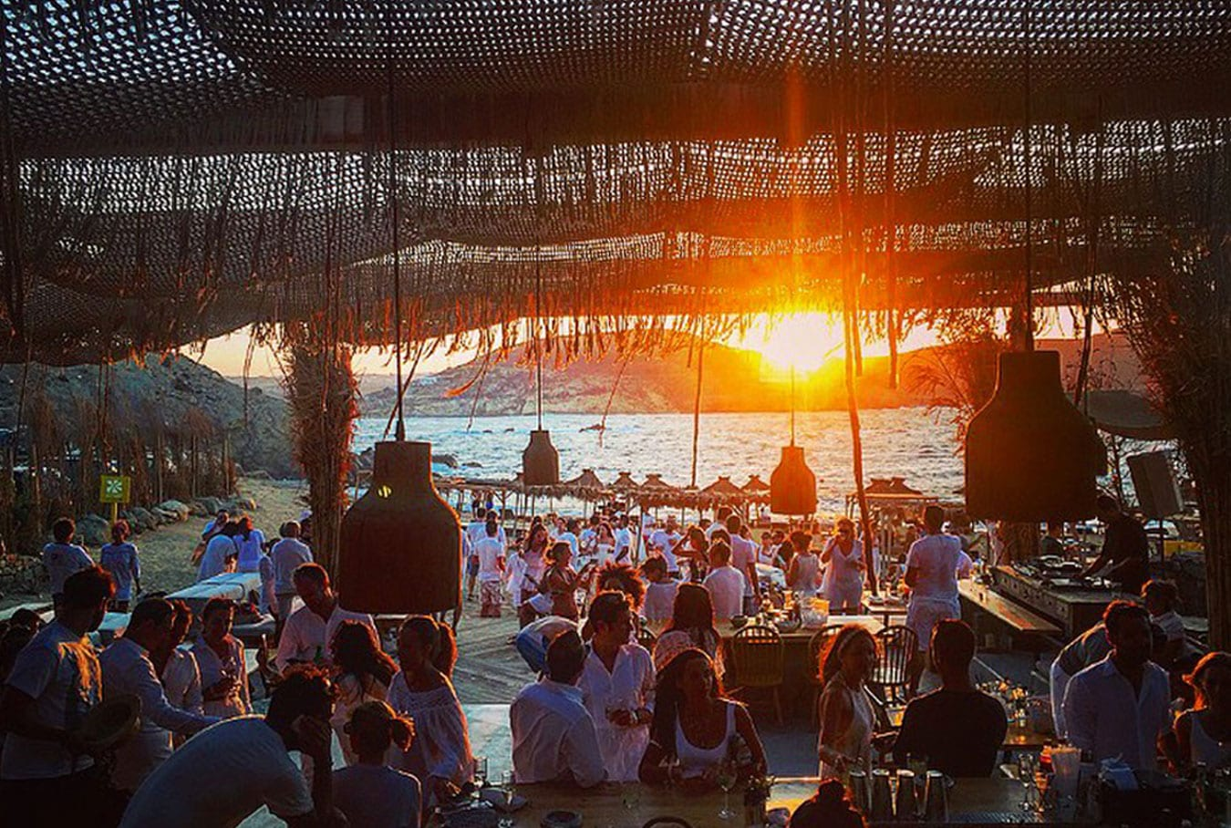 Trendy Alemagou beach restaurant and bar in Mykonos at sunset