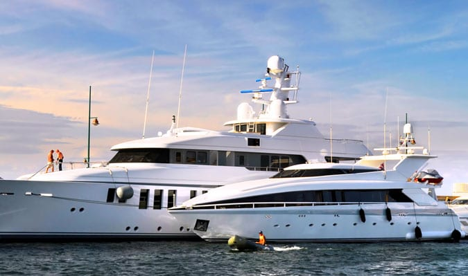 yacht sales image of two mega yachts