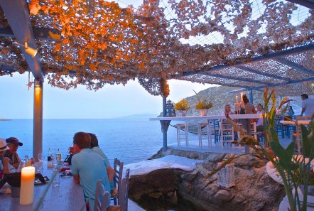 dining in Mykonos at sunset by the sea