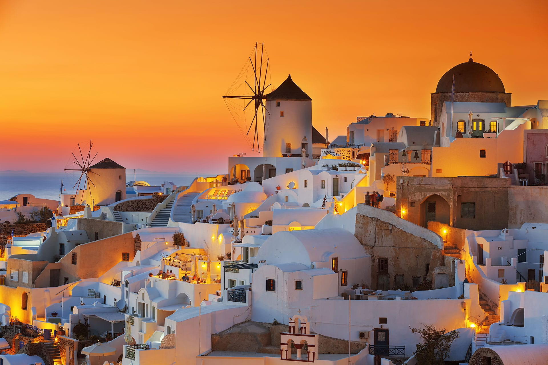 Santorini at sunset seeing windmills