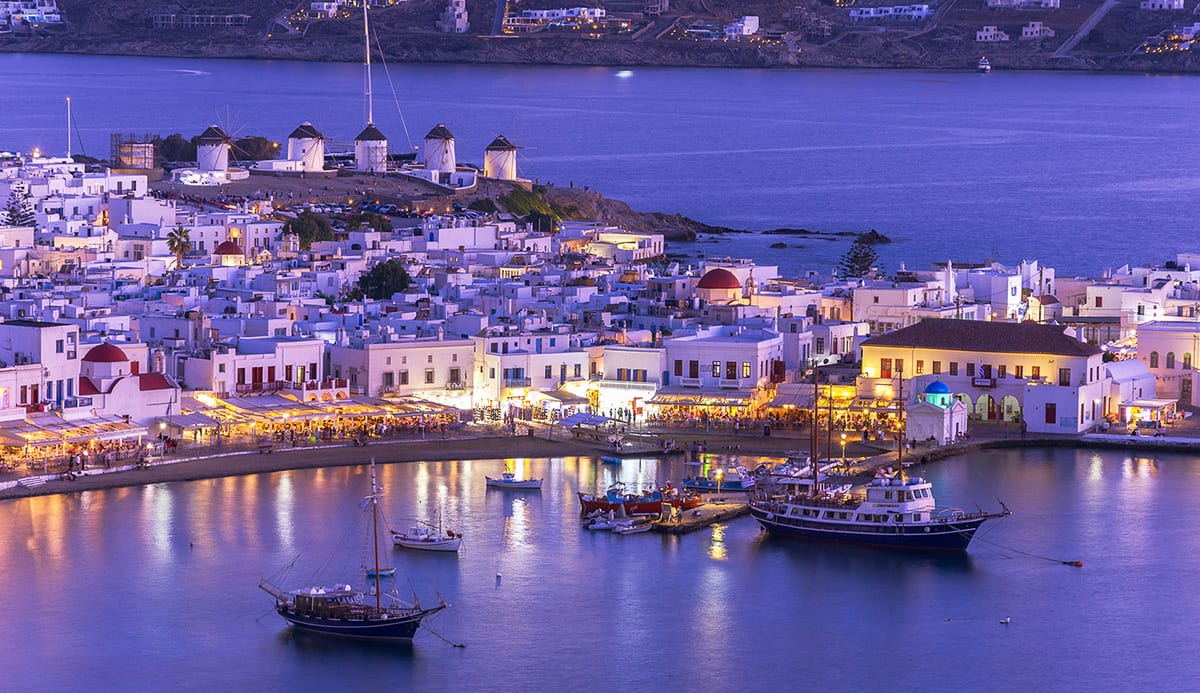a magical scene of mykonos port at sunset