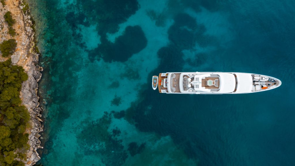 a megayacht seen from an aerial view at coast