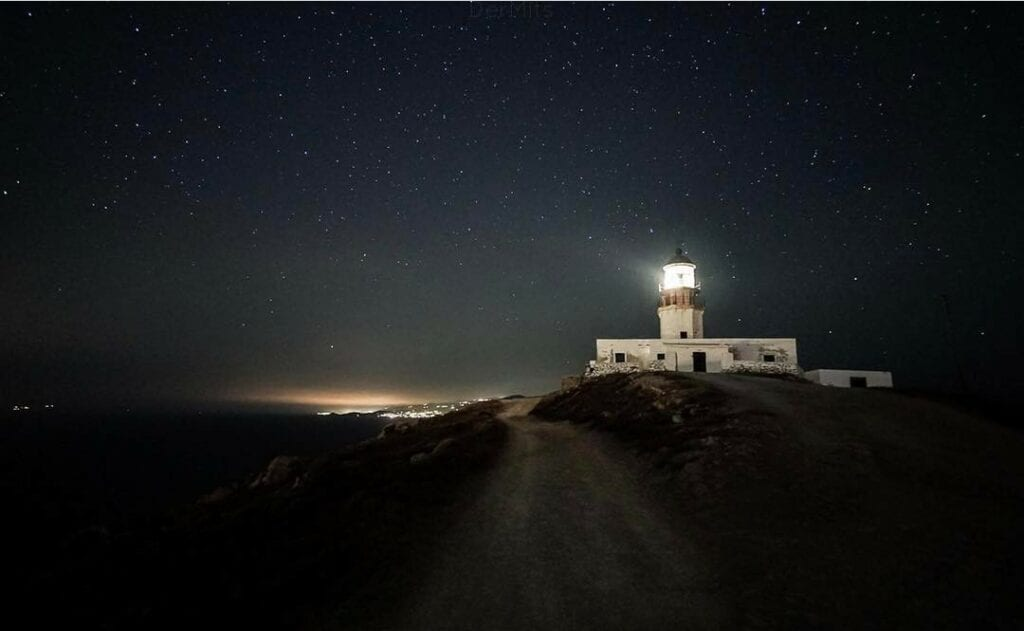 lighthouse in Greece at night