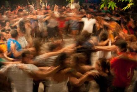 a ring of dancers at a panayiri