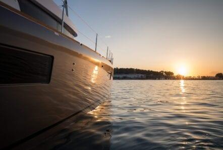 side view of catamaran at sunset