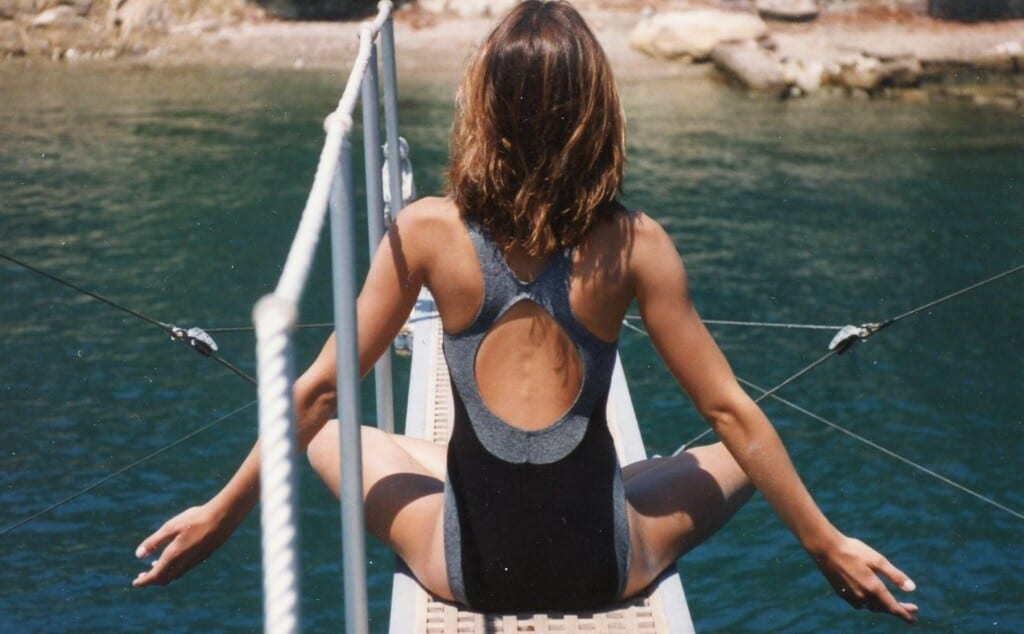 back of a girl on a boat