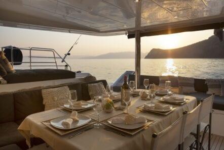 boom lagoon catamaran dining (1) min - Valef Yachts Chartering