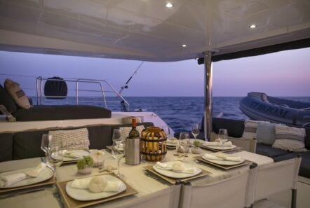 boom lagoon catamaran dining (2) min - Valef Yachts Chartering