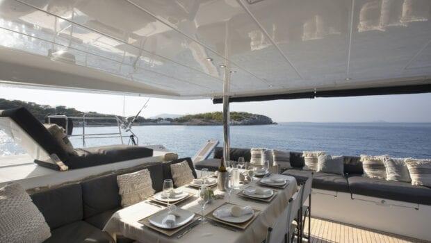 boom lagoon catamaran dining (3) min - Valef Yachts Chartering