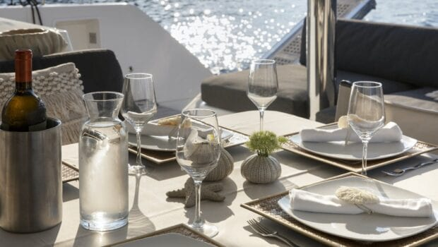 boom lagoon catamaran dining (6) min - Valef Yachts Chartering