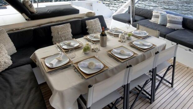 boom lagoon catamaran dining (8) min - Valef Yachts Chartering