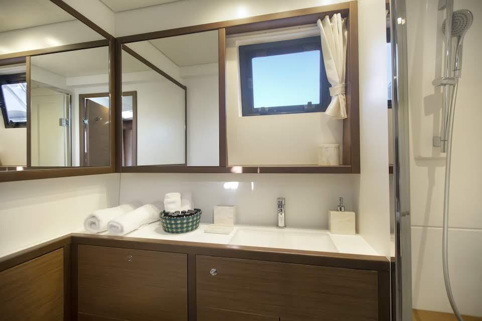 boom lagoon catamaran wc (2) min - Valef Yachts Chartering