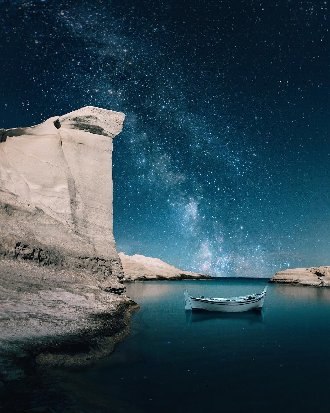 milos at night stars and fishing boat